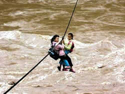 Students Cross Raging River on Zip Line to Get to Class